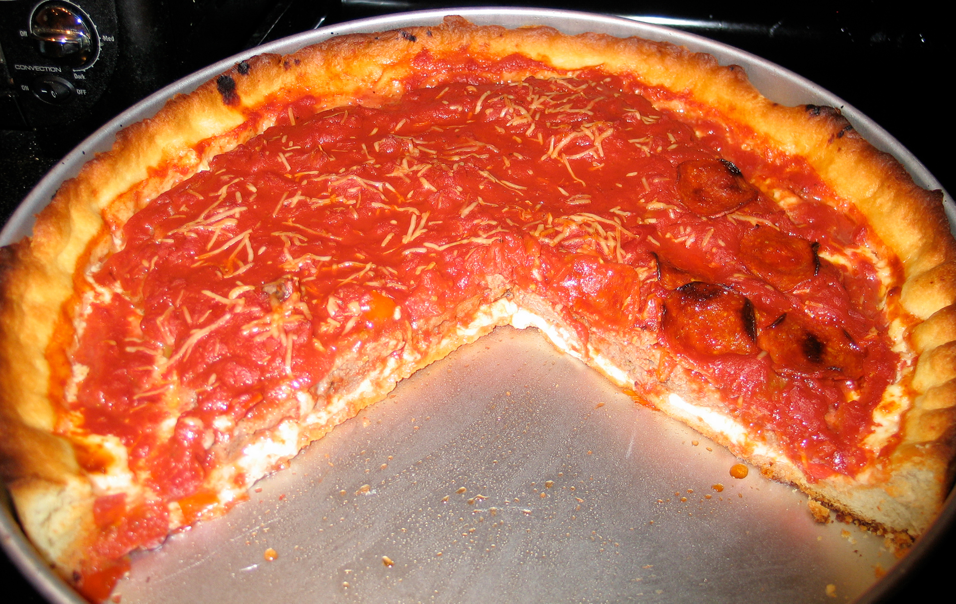 photo of my first home made deep dish pizza in the pan, with slices removed