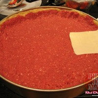 2 lbs of lean ground sirloin are pressed into a solid patty and worked up the sides. Then comes the cheese.
