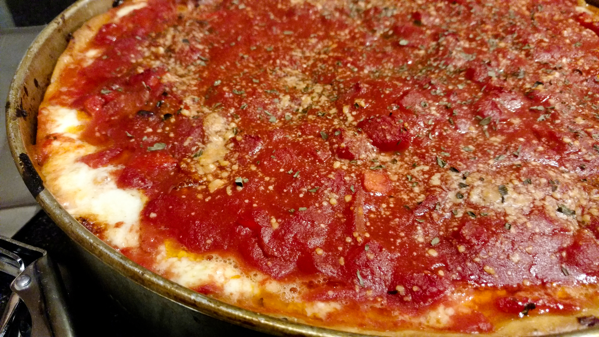 photo of a deep dish pizza